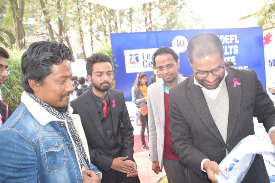 KIEC MD Rajendra Rijal Presenting KIEC Tshirt to Nischal Basnet